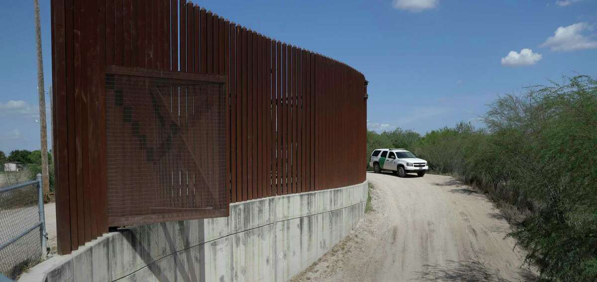 FILE - In this Aug. 11, 2017, file photo, a U.S. Customs and Border Patrol vehicle passes along a section of border levee wall in Hidalgo, Texas. (AP Photo/Eric Gay, File)