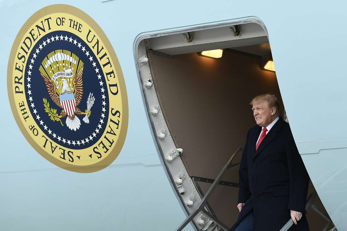 FILE - In this April 15, 2019, file photo, President Donald Trump walks down the steps of Air Force One at Andrews Air Force Base in Md. Four California voters have sued Monday, Aug. 5, 2019, to block a new state law aimed at forcing Republican President Donald Trump to release his personal income tax returns. Democratic Gov. Gavin Newsom signed a law last week that requires presidential candidates to file five years of their income tax returns with the California Secretary of State at least 98 days prior to the primary election. Candidates who don't do it won't appear on the ballot. (AP Photo/Susan Walsh, File)