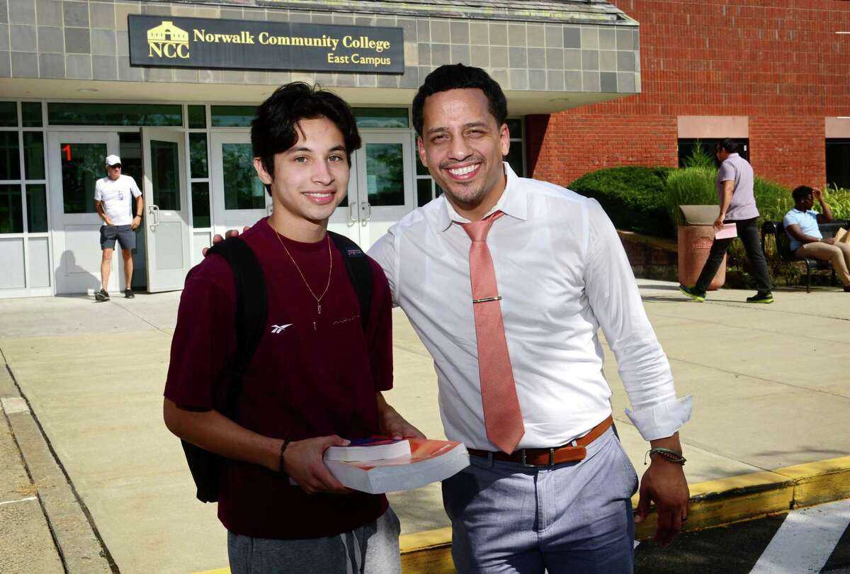 """Norwalk Community College student and Bridge to College program participant Nevin Avila meets with one of the program's counselors, Thomas Agosto, Thursday, August 29, 2019, at NCC in Norwalk, Conn. The new pilot program aims to decrease the number of Stamford Public Schools students who graduate with the intention of attending college but fail to follow through come the fall, a phenomena known as """"summer melt."""""""