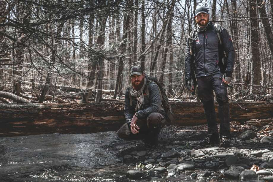 "Wilderness experts and brothers Casey and Chris Keefer — photographed here in July 2019 — go where most wouldn't dare, in search of answers to history's greatest mysteries in Travel Channel's ""Code of the Wild."" One of their treks took them to Stony Creek, N.Y. in pursuit of Dutch Schultz's hidden fortune in April 2019. Photo: Courtesy Of Travel Channel"