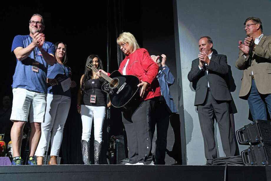 Maureen Kersten of Dickinson is given a Rascal Flatts autographed guitar in recognition of being the one millionth fan at the Smart Financial Centre on Thursday, Aug. 29. Photo: Craig Moseley, Houston Chronicle / Staff Photographer / ©2019 Houston Chronicle