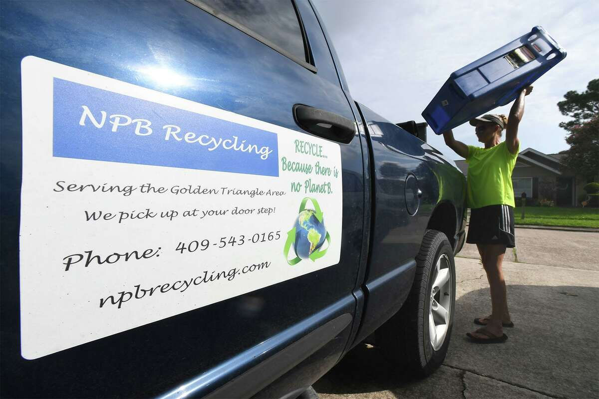 Co-owners of NPB recycling, Stacey Wheeler picks up recyclable material in Port Neches on Wednesday. The two women collect the material and bring it to facilities in Port Arthur and Houston to be recycled. Aycock said they collect all plastics, paper, any metal, aluminum, batteries, glass and cardboard. Photo taken Wednesday, 8/28/19
