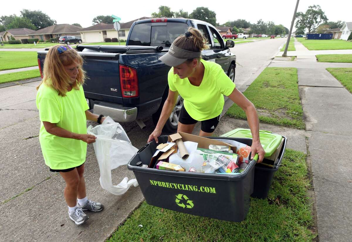 Owners of NPB recycling, Stacey Wheeler, right, and Nickey Aycock pick up recyclable material in Port Neches on Wednesday. The two women collect the material and bring it to facilities in Port Arthur and Houston to be recycled. Aycock said they collect all plastics, paper, any metal, aluminum, batteries, glass and cardboard. Photo taken Wednesday, 8/28/19
