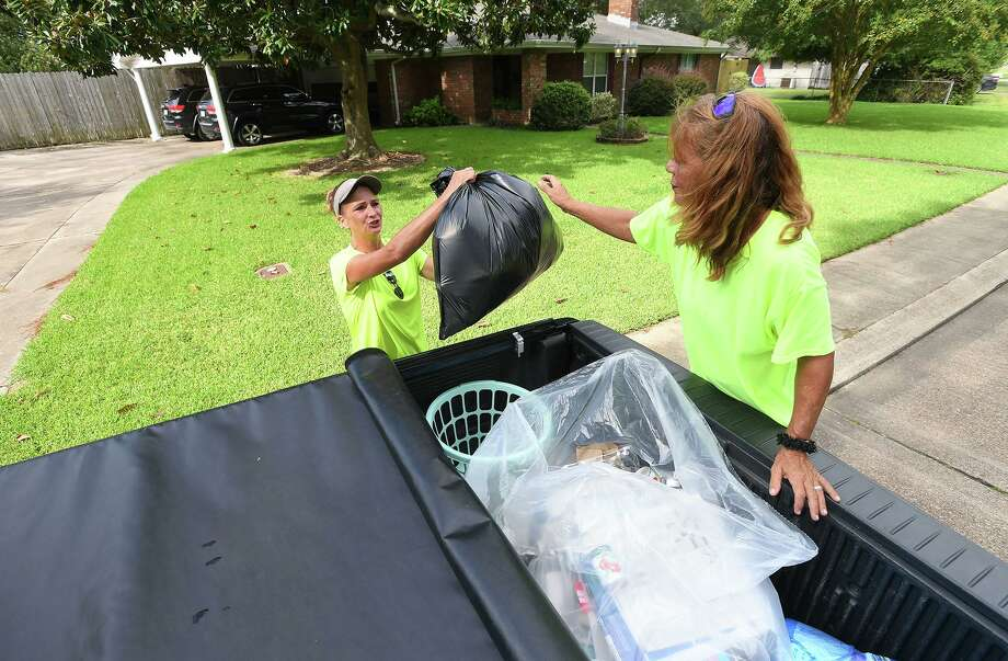 Owners of NPB recycling, Stacey Wheeler, left, and Nickey Aycock pick up recyclable material in Port Neches on Wednesday. The two women collect the material and bring it to facilities in Port Arthur and Houston to be recycled. Aycock said they collect all plastics, paper, any metal, aluminum, batteries, glass and cardboard.  Photo taken Wednesday, 8/28/19 Photo: Guiseppe Barranco/The Enterprise, Photo Editor / Guiseppe Barranco ©