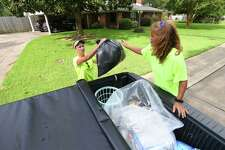 Owners of NPB recycling, Stacey Wheeler, left, and Nickey Aycock pick up recyclable material in Port Neches on Wednesday. The two women collect the material and bring it to facilities in Port Arthur and Houston to be recycled. Aycock said they collect all plastics, paper, any metal, aluminum, batteries, glass and cardboard. Photo taken Wednesday, 8/28/19