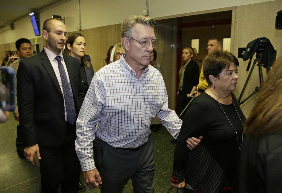 File - In this Nov. 30, 2017 file photo, Jim Steinle, center, and Liz Sullivan, right, the parents of Kate Steinle, walk to a court room for closing arguments in the trial of Jose Ines Garcia Zarate who was accused of killing their daughter, in San Francisco. Photo: Eric Risberg/AP
