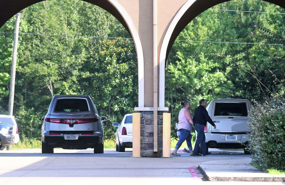 Guests to Harley Joe Morgan and Rhiannon Marie Morgan's funeral walk past two hearses at Turning Point Church in Vidor Friday. The Morgans were killed last week in a car wreck shortly after the two were married. Photo taken Friday, 8/30/19 Photo: Guiseppe Barranco/The Enterprise, Photo Editor / Guiseppe Barranco ©