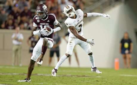 Texas A&M defensive back Myles Jones (10) intercepts a pass intended for Texas State wide receiver Jeremiah Haydel (3) during the first half of an NCAA college football game Thursday, Aug. 29, 2019, in College Station, Texas. (AP Photo/Sam Craft)