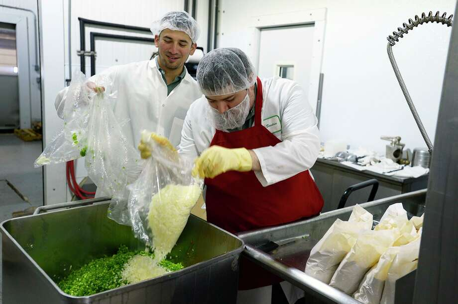 Workers prepare loads of onion, green onion and peppers to be mixed in with rice, meat and spices to make boudin at the D.J.'s Boudain plant in Beaumont.  Photo taken Wednesday 3/7/18 Ryan Pelham/The Enterprise Photo: Ryan Pelham / Ryan Pelham/The Enterprise / ©2018 The Beaumont Enterprise/Ryan Pelham