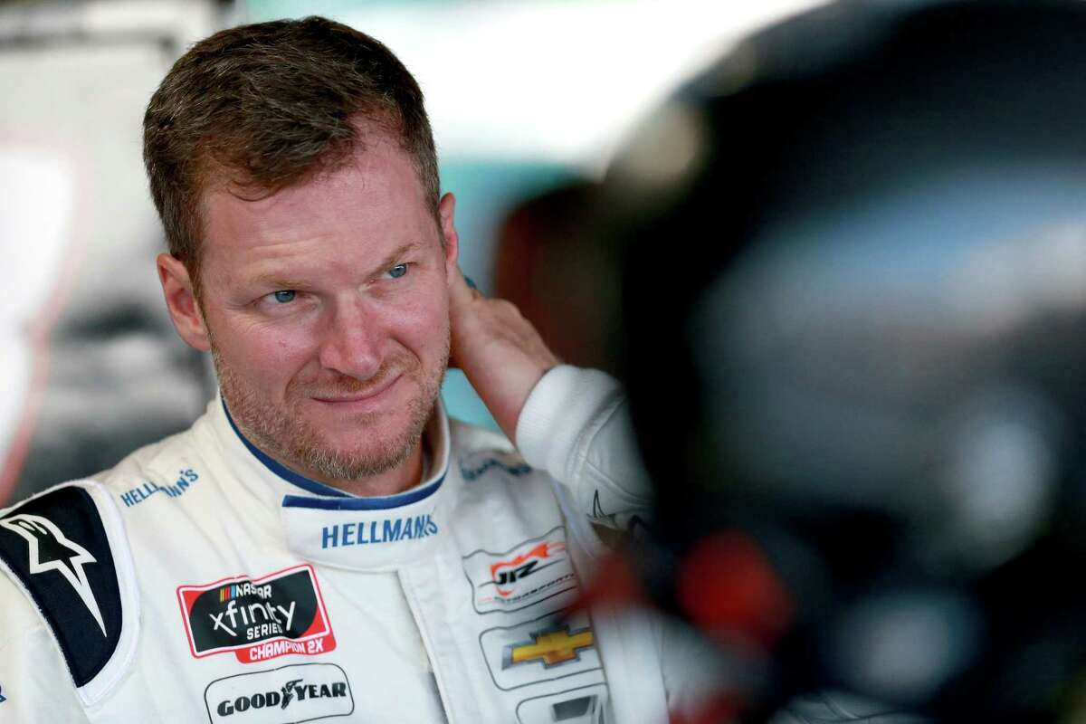 DARLINGTON, SOUTH CAROLINA - AUGUST 30: Dale Earnhardt Jr., driver of the #8 Hellmann's Chevrolet, stands in the garage during practice for the NASCAR Xfinity Series Sport Clips Haircuts VFW 200 at Darlington Raceway on August 30, 2019 in Darlington, South Carolina. (Photo by Sean Gardner/Getty Images)