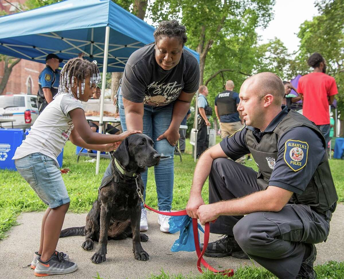 Albany police Officer Kyle Haller and Albany police therapy dog Maxie interact with the public in this undated photo.