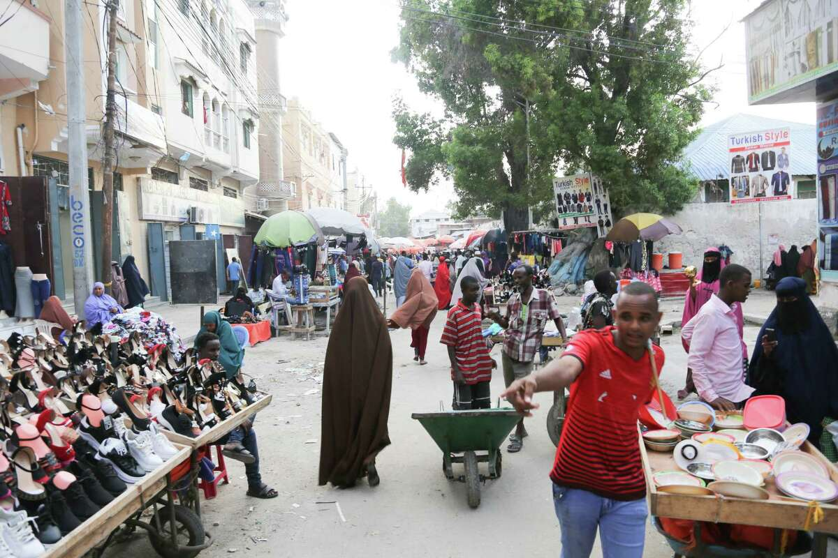 A market in the Somali capital, Mogadishu. Business owners say al-Shabab gives them a stark choice: pay tax or pay with their lives.