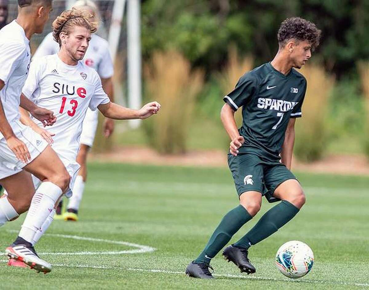 Alaa Algahim of Michigan State, right, controls the ball as SIUE's Kelby Phillips (13) closes in Friday during the 0-0 double-overtime tie in East Lansing, Mich.