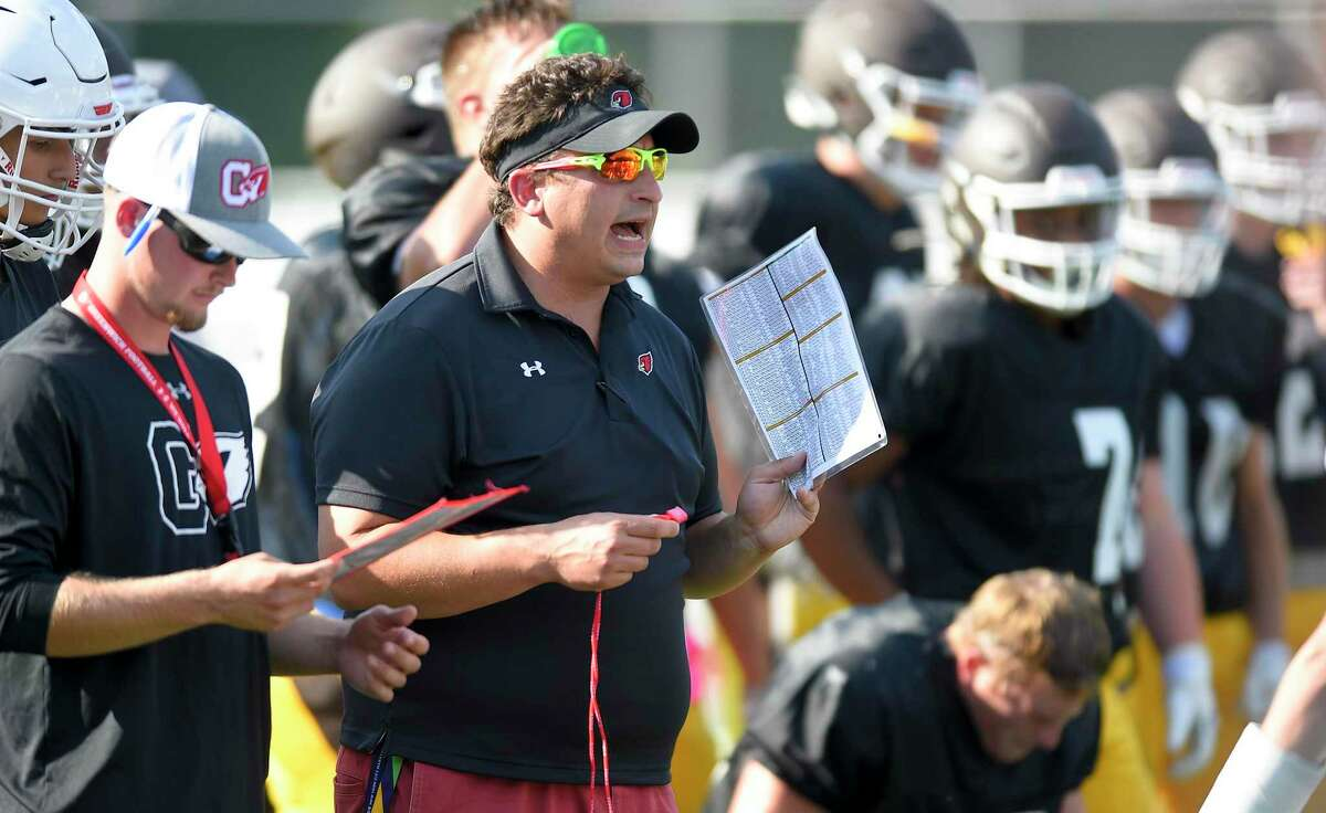 Greenwich head coach Anthony Morello shouts at his players during a scrimmage football game against Brunswick at Cardinal Stadium on August 30, 2019 in Greenwich, Connecticut.