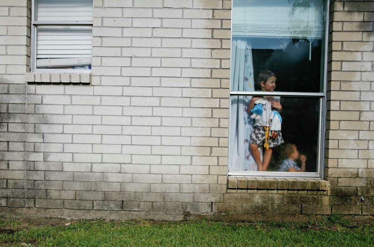Jenna Clements, 4, holds onto her Jesus doll and and a stuffed bear that were given to her to help her deal with Harvey aftermath with her brother Jackson, 4, in their Katy, Texas home on on Friday, Aug. 30, 2019 in Katy, Texas. The family was flooded out of their last home from Harvey.