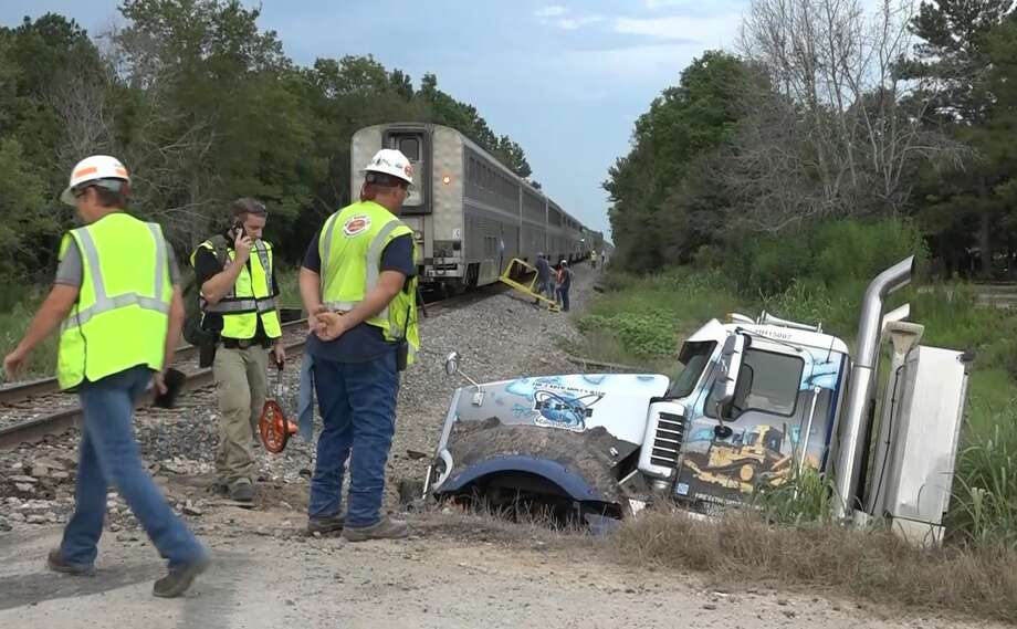 An 18-wheeler collided with an Amtrak passenger train around 4 p.m. Friday in Dayton, Texas, injuring 19 people. Some of the 70 passengers on the New Orleans-bound train were still on the train three hours after the collision. Photo: Scott Engle / Montgomery County Police Reporter