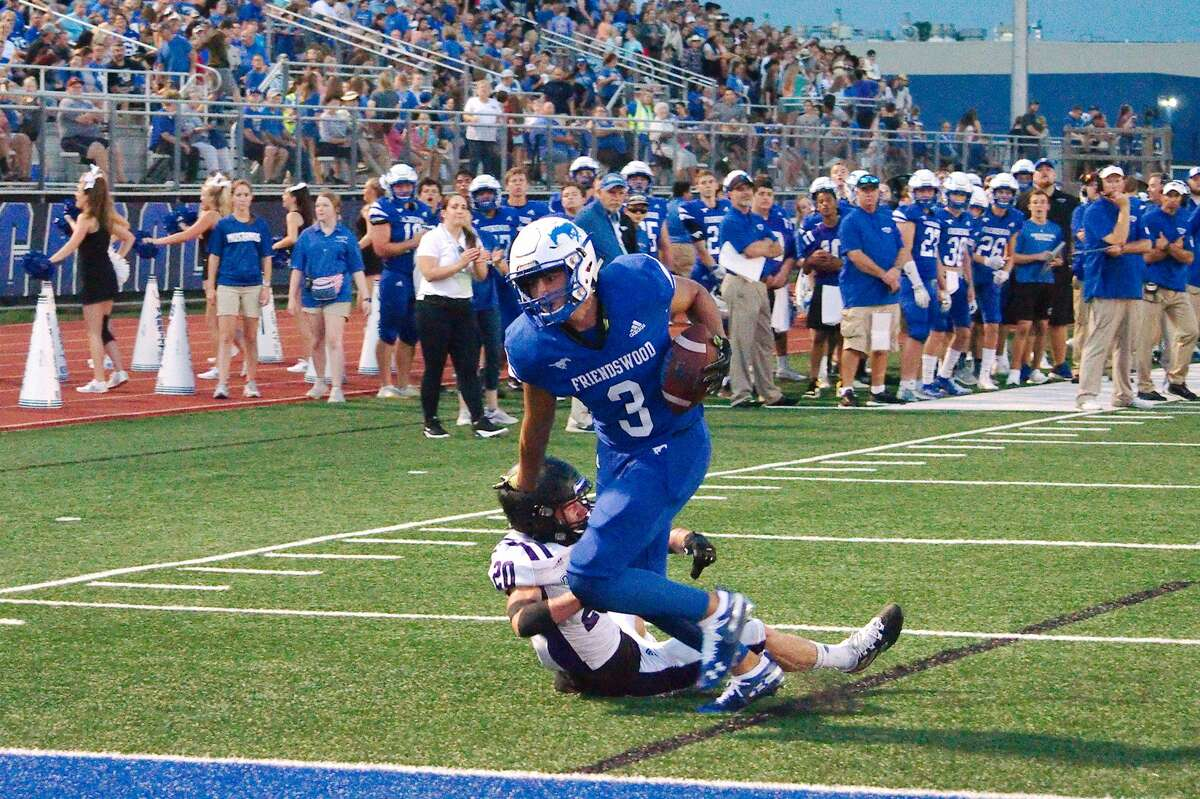 Friendswood's Matthew Kovacevich (3) fights into the end zone against Dayton Friday, Aug. 30 at Friendswood High School.