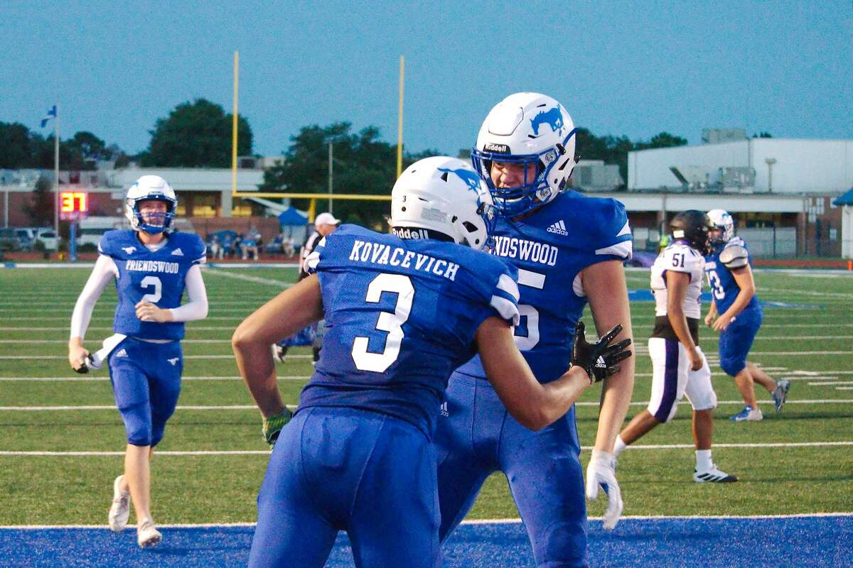 Friendswood's Matthew Kovacevich (3) and Cole Kelly (85) celebrate a touchdown against Dayton Friday, Aug. 30 at Friendswood High School.
