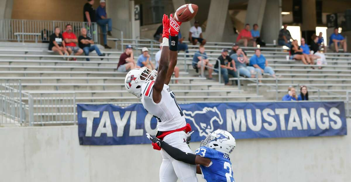 Atascocita Eagles wide receiver Darius Edmonds attempts to make a touchdown catch during the high school football game between the Atascocita Eagles and Katy Taylor Mustangs at Legacy Stadium in Katy, Texas on August 30, 2019.