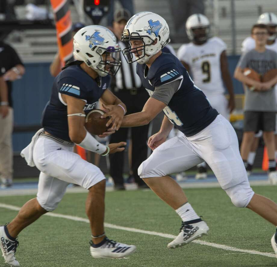 Greenwood quarterback Weston Wilber hands the ball off to Trey Cross against Big Spring at J.M. King Memorial Stadium on 08/30/19 Tim Fischer/Reporter-Telegram Photo: Tim Fischer/Midland Reporter-Telegram