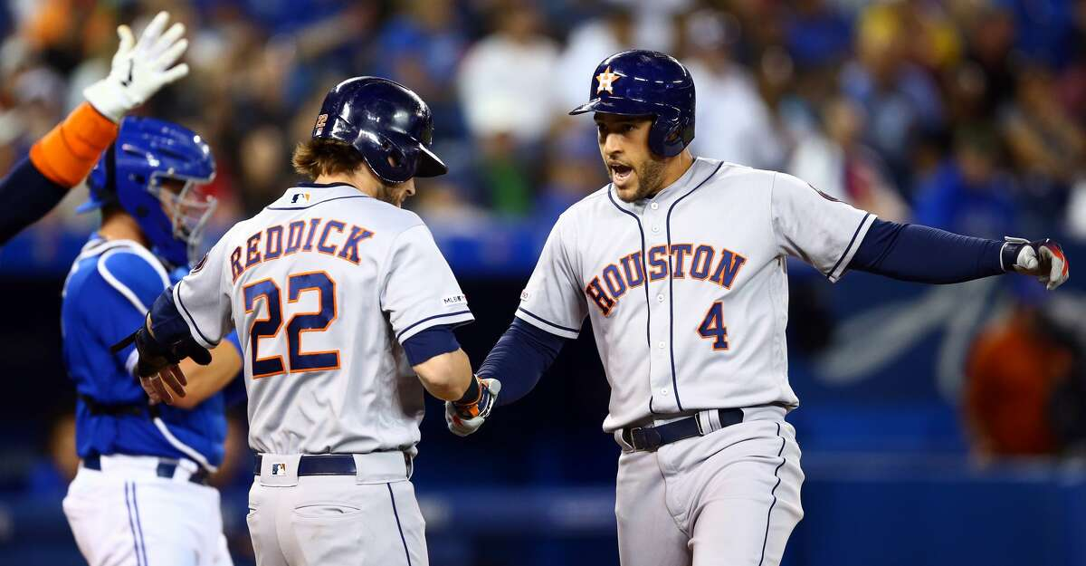TORONTO, ON - AUGUST 30: George Springer #4 of the Houston Astros celebrates with Josh Reddick #22 after hitting a 3 run home run in the fifth inning during a MLB game against the Toronto Blue Jays at Rogers Centre on August 30, 2019 in Toronto, Canada. (Photo by Vaughn Ridley/Getty Images)