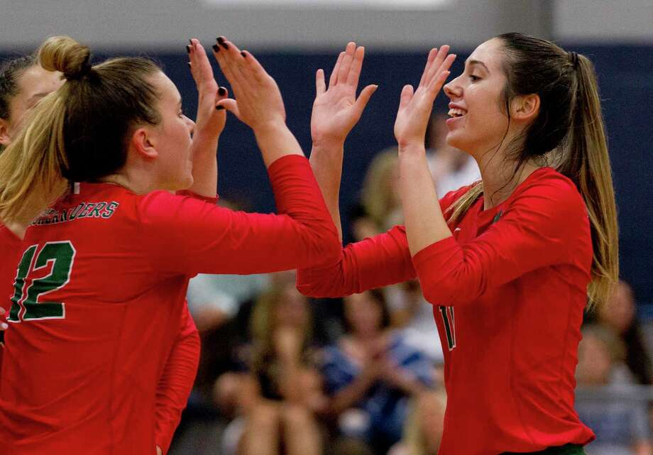 The Woodlands middle hitter Natasha Zorbas (11) gets a high-five from setter Clara Brower (12) in the third set of a non-district high school volleyball match at Concordia Lutheran High School, Tuesday, Aug. 27, 2019, in Tomball. Photo: Jason Fochtman, Houston Chronicle / Staff Photographer / Houston Chronicle