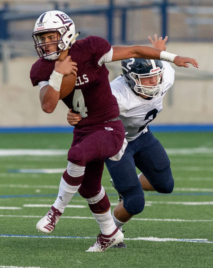 Lee's Mikey Serrano (4) breaks through Smithson Valley's Thomas Zeug's (2) tackle Friday, August 30 at Grande Communications Stadium. Photo: Jacy Lewis/Reporter-Telegram
