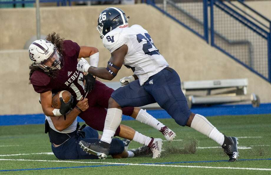 Lee's Ryan Quiroz (16) is brought down by Smithson Valley's James Deardurff on Friday, August 30 at Grande Communications Stadium. Photo: Jacy Lewis/Reporter-Telegram