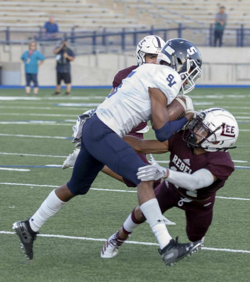 Smithson Valley's Greg Eggleston (5) is tackled by Lee's Bruce Franco on Friday, August 30 at Grande Communications Stadium. Photo: Jacy Lewis/Reporter-Telegram