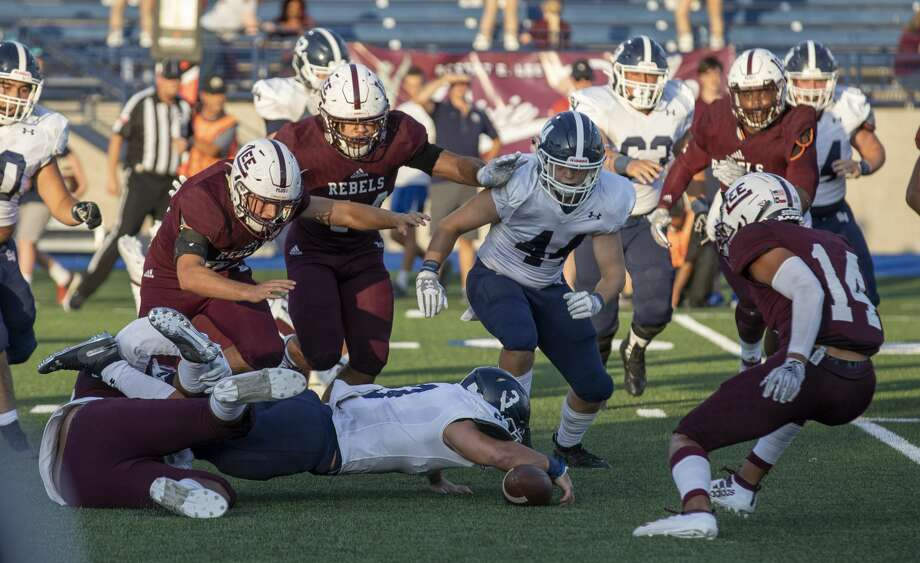 Smithson Valley's Jacob Forton (3) fumbles the ball Friday, August 30 at Grande Communications Stadium. Photo: Jacy Lewis/Reporter-Telegram