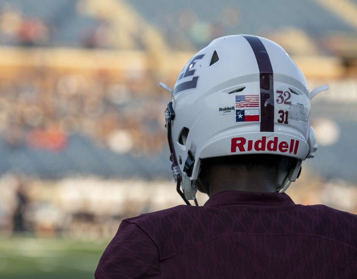 Midland Lee's Tra Arnold (31) wears a sticker on his helmet to remember Cedric Benson (32) -- who died in a motorcycle wreak last week -- Friday, August 30 at Grande Communications Stadium.