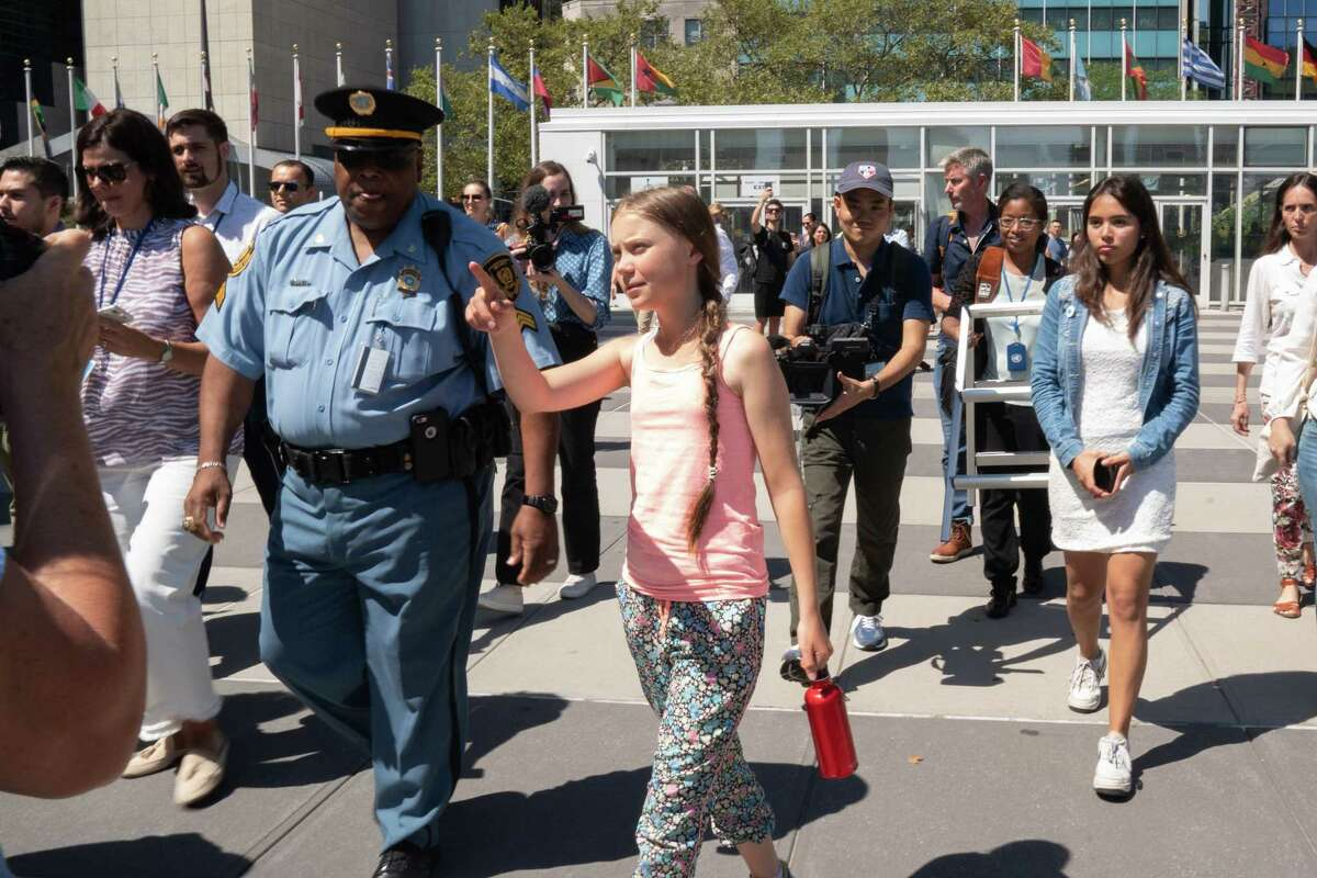 Greta Thunberg arrives at UN headquarters as part of the Youth Climate Strike on August 30, 2019 in New York. - Swedish climate change campaigner Greta Thunberg joined hundreds of other teenagers protesting outside the United Nations Friday in her first demonstration on US soil since arriving by zero-carbon yacht. Thunberg, 16, has spurred teenagers and students around the world to gather every Friday under the rallying cry
