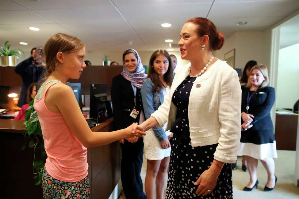 CORRECTS ID TO U.N. GENERAL ASSEMBLY PRESIDENT MARAA FERNANDA ESPINOSA GARCES, NOT TIJJANI MUHAMMAD-BANDE - Swedish environmental activist Greta Thunberg, left, is greeted by U.N. General Assembly President MarA-a Fernanda Espinosa Garces as she arrives in the United Nations, Friday, Aug. 30, 2019. Thunberg is scheduled to address the United Nations Climate Action Summit on September 23. (AP Photo/Mary Altaffer)