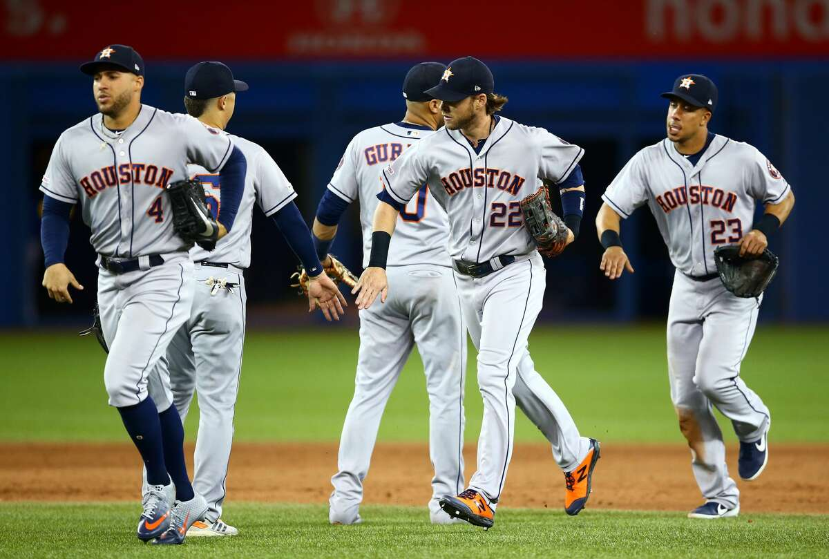 TORONTO, ON - AUGUST 30: Josh Reddick #22 of the Houston Astros celebrates with teammates following victory during a MLB game against the Toronto Blue Jays at Rogers Centre on August 30, 2019 in Toronto, Canada. (Photo by Vaughn Ridley/Getty Images)