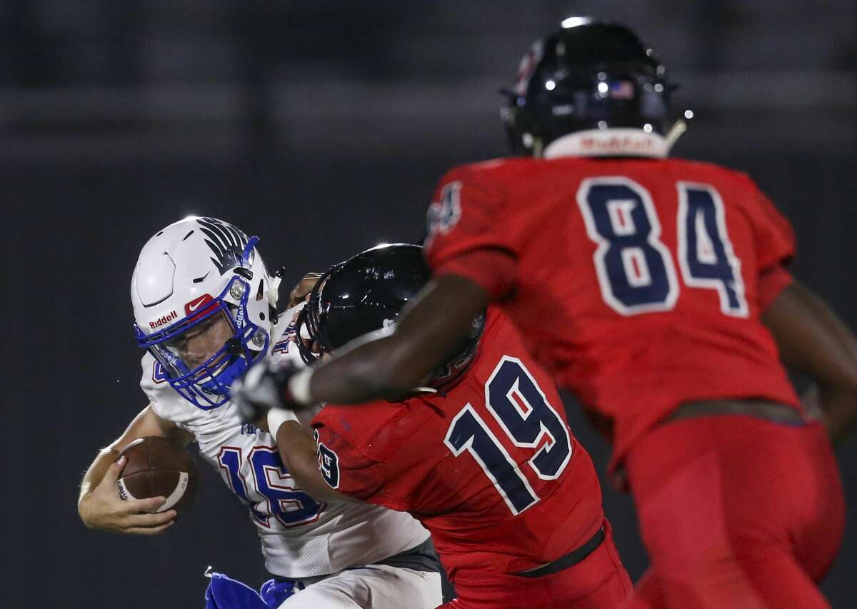 USA: TX: Pearland: Oak Ridge War Eagles quarterback Nick Osborne (16) is sacked for a loss by Dawson Eagles Nodirbek Muminov (19) in the fourth quarter on August 30, 2019 at The Rig in Pearland, TX.