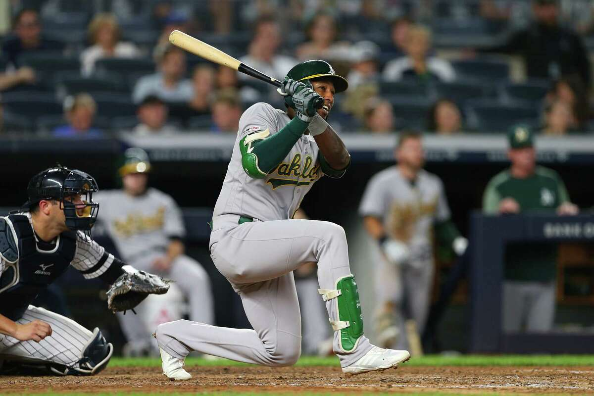 NEW YORK, NY - AUGUST 30: Jurickson Profar #23 of the Oakland Athletics hits a two-run double against the New York Yankees during the sixth inning of a game at Yankee Stadium on August 30, 2019 in New York City. (Photo by Rich Schultz/Getty Images)
