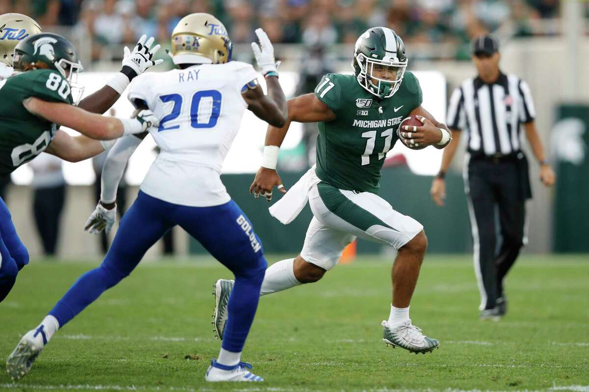 EAST LANSING, MI - AUGUST 30: Connor Heyward #11 of the Michigan State Spartans runs with the ball against the Tulsa Golden Hurricane in the first quarter at Spartan Stadium on August 30, 2019 in East Lansing, Michigan. (Photo by Joe Robbins/Getty Images)