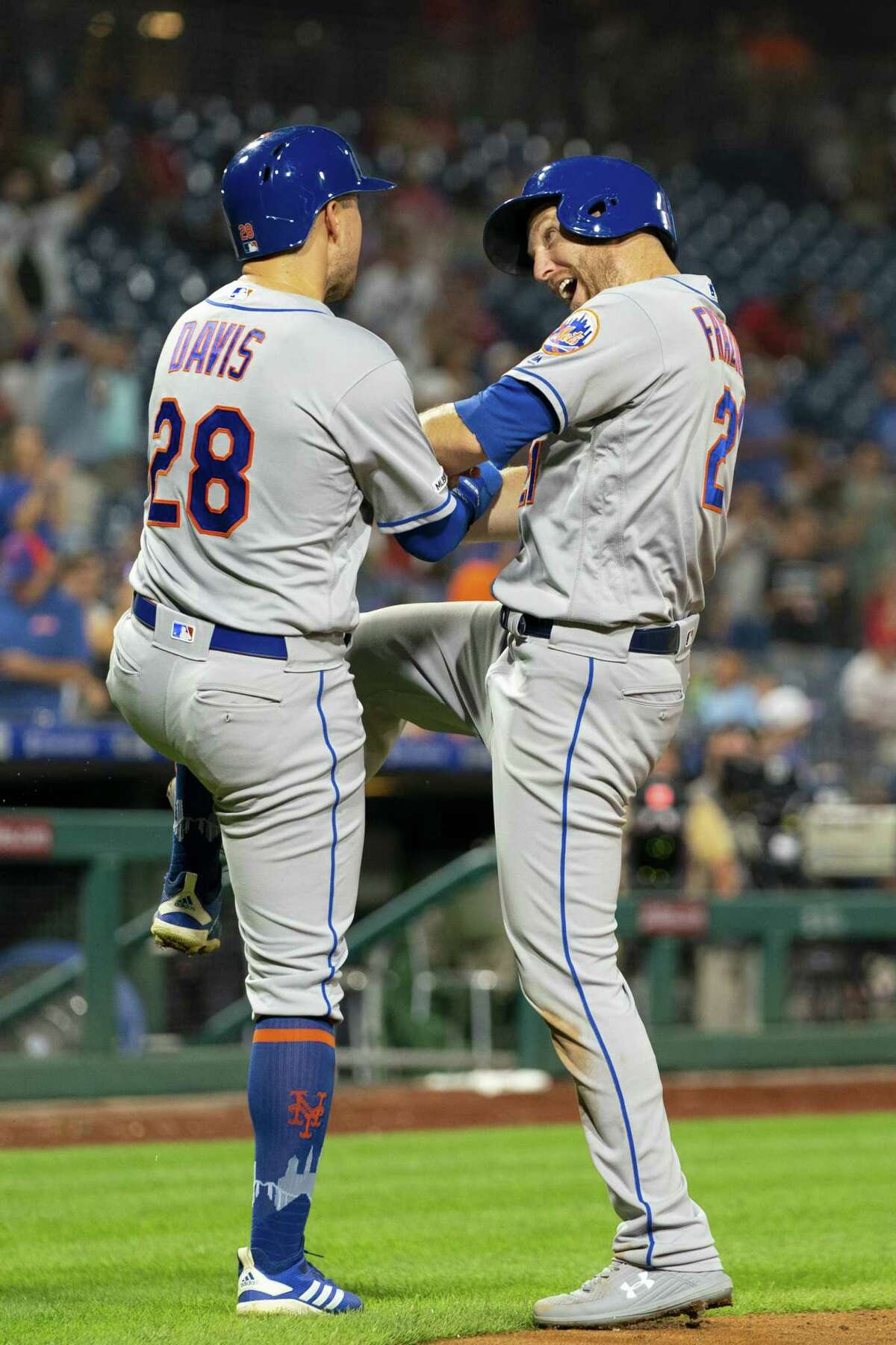 PHILADELPHIA, PA - AUGUST 30: Todd Frazier #21 of the New York Mets celebrates with J.D. Davis #28 after hitting a three run home run in the top of the ninth inning against the Philadelphia Phillies at Citizens Bank Park on August 30, 2019 in Philadelphia, Pennsylvania. The Mets defeated the Phillies 11-5. (Photo by Mitchell Leff/Getty Images)