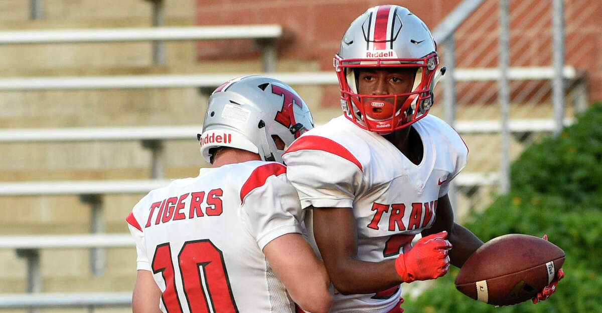 Travis wide receiver Jarrell Farr, right, celebrates his touchdown with quarterback Jakolby Longino during the first half of a high school football game against Hightower, Friday, Aug. 30, 2019, in Iowa Colony, TX.