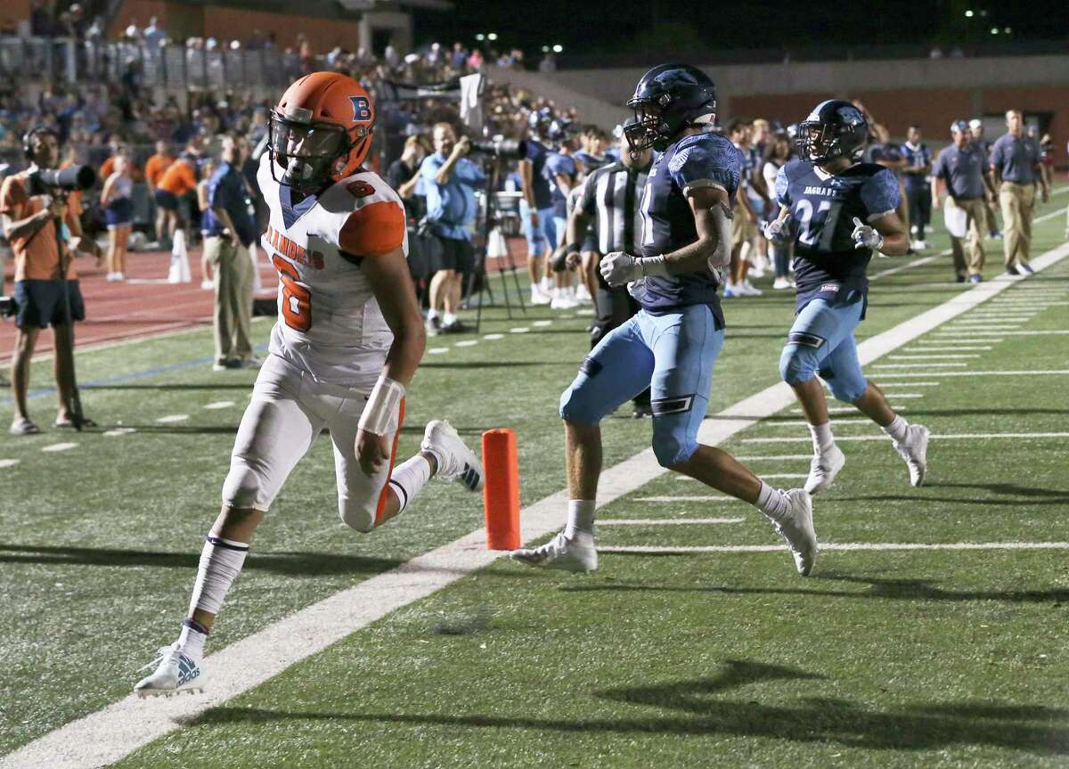 Brandeis quarterback Jordan Battles (06) sprints in for a touchdown against Johnson's Colton Lee (31) and Matthew Rodriguez (27) in the first half of their football game at Heroes Stadium on Friday, Aug. 30, 2019. (Kin Man Hui/San Antonio Express-News)