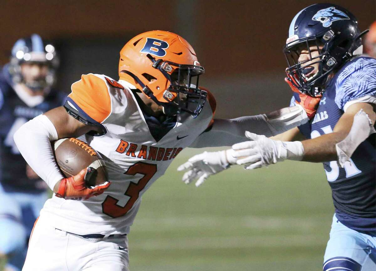 Brandeis running back Corion Holmes (03) stiff arms Johnson's Colton Lee (31) during their football game at Heroes Stadium on Friday, Aug. 30, 2019. (Kin Man Hui/San Antonio Express-News)