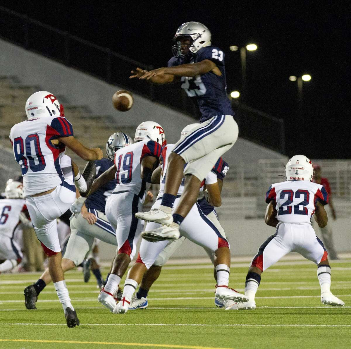 College Park linebacker Marcell Faulkner (23) blocks a punt by Aldine Davis punter Carlos Pardo (80) during the first quarter of a non-district high school football game at Woodforest Bank Stadium, Friday, Aug. 30, 2019, in Shenandoah. Faulkner recovered the blocked punt in the endzone for a touchdown.