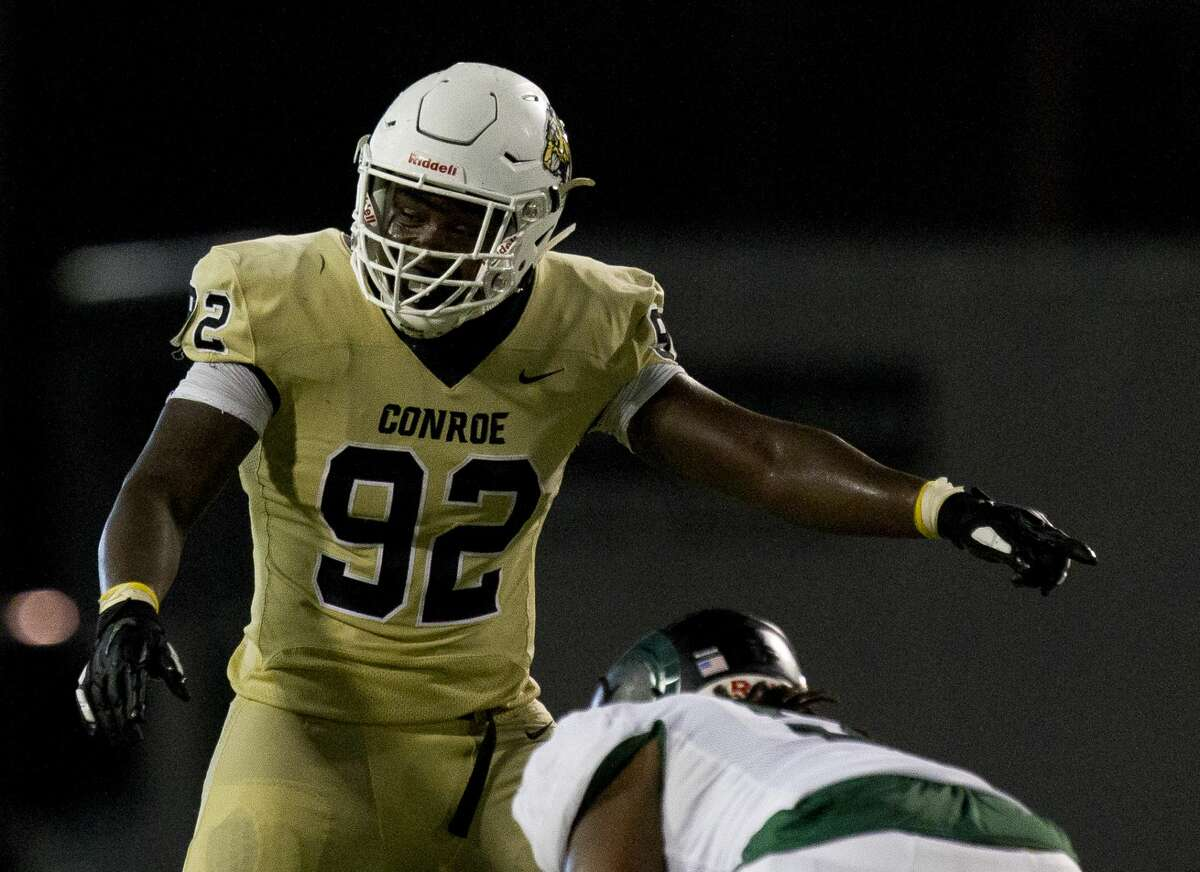 Conroe defensive linemen Dominique Ratcliff (92) directs players during the fourth quarter of a non-district high school football game at Buddy Moorhead Stadium, Friday, Aug. 30, 2019, in Conroe.