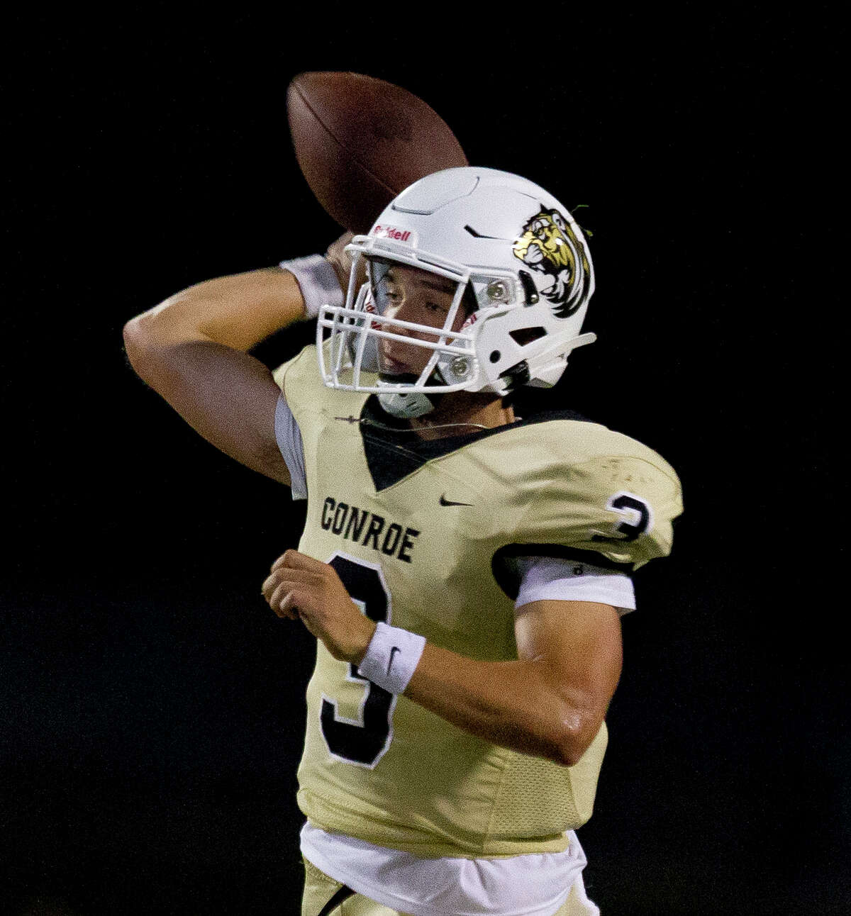 Conroe quarterback Christian Pack (3) throws a pass during the third quarter of a non-district high school football game at Buddy Moorhead Stadium, Friday, Aug. 30, 2019, in Conroe.