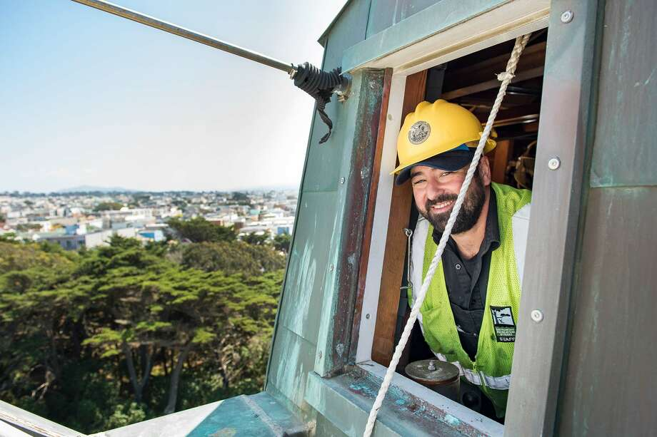 David Daniel peers out of the very top of the Murphy Windmill in Golden Gate Park. Photo: Blair Heagerty / SFGate