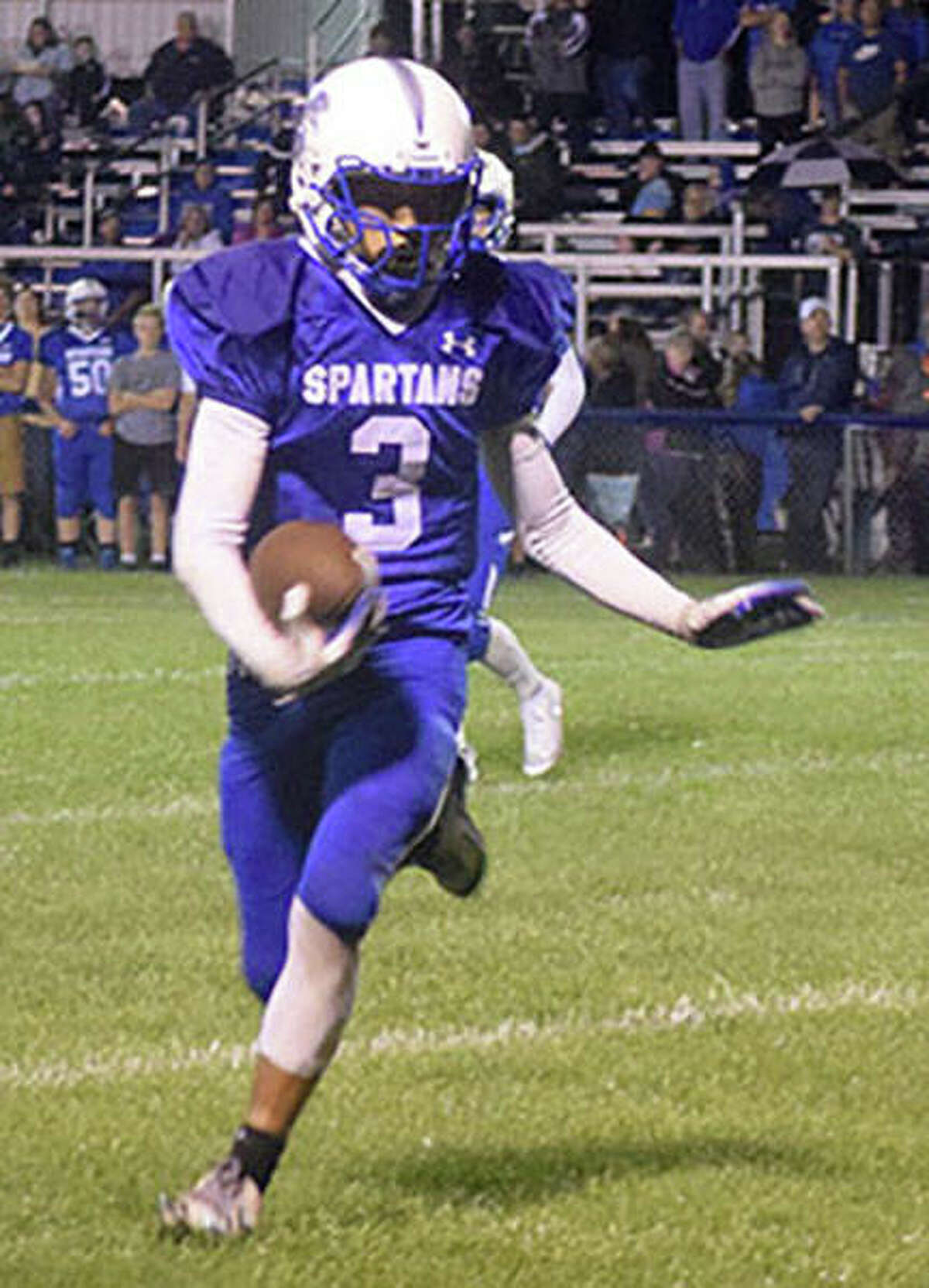 North Greene quarterback Dalton Mitchell turns the corner on a run during the Spartans' victory over Concord Triopia on Friday night in White Hall.