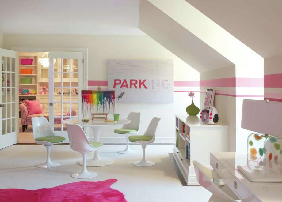 Self-expression is important in child development. 'Use colors that speak to children and be sure to represent their personality in their room, even around their study space,' recommends interior designer Carey Karlan, owner of Last Detail Interior Design in Darien. Here, she pairs white with pops of color and sophisticated furnishings to create a teen's home work/study space Photo: Jane Beiles / Connecticut Post