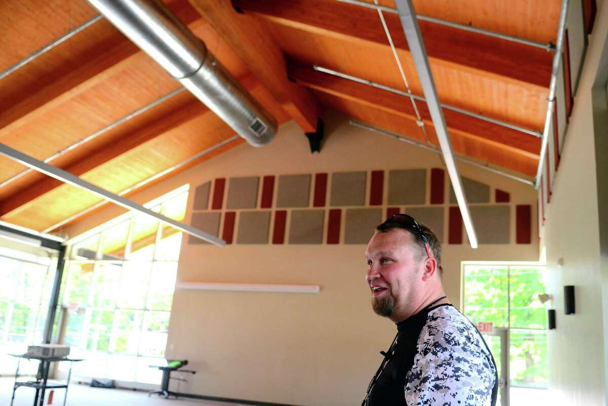 Derby High School football coach Goerge French gives a tour of the new J.R. Payden Field House in Derby on Friday.