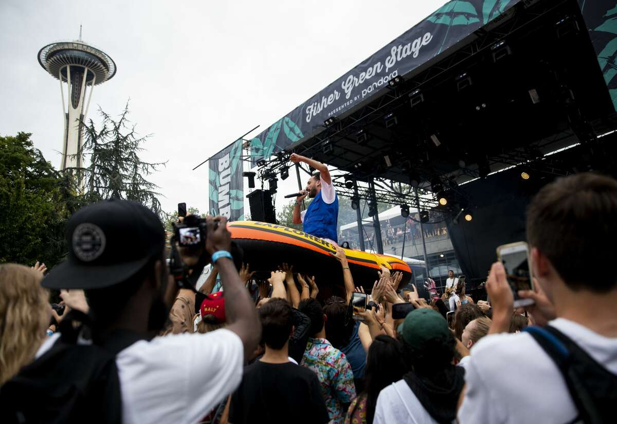 Seattle rapper Sol rides an inflatable raft in the crowd at the Fisher Green Stage on the first day of Bumbershoot at Seattle Center, Friday, Aug. 30, 2019.
