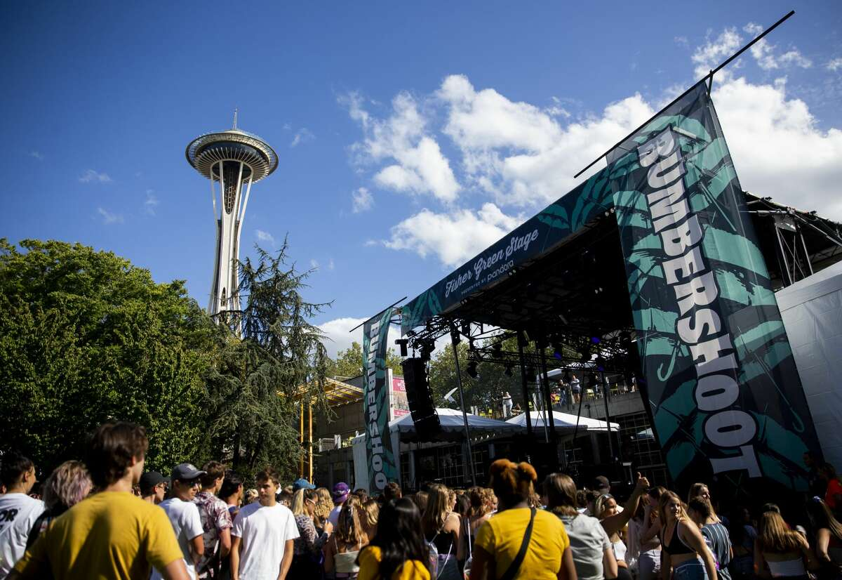 Festivalgoers gather to watch rapper Jasiah at the Fisher Green Stage on the first day of Bumbershoot at Seattle Center, Friday, Aug. 30, 2019. (Lindsey Wasson, seattlepi.com)